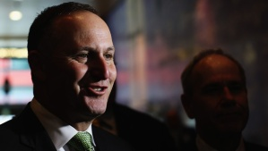 John-Key-announces-10b-auckland-transport-package-with-Len-Brown-in-shadow--28jun2013--Getty-Images