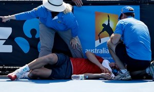 Frank Dancevic lies on the court after collapsing during his match